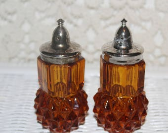 Pair of vintage Diamond Cut Glass Amber SAlt & Pepper Shakers with Chrome Dome Lids