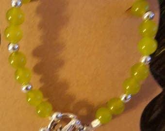 Peridot bracelet with toggle closure.