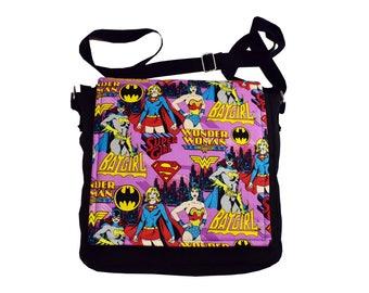 Female Superhero Handbag (Pink). Wonder Woman, Supergirl and Batgirl messenger style bag, the perfect gift for any lover of superheroes.