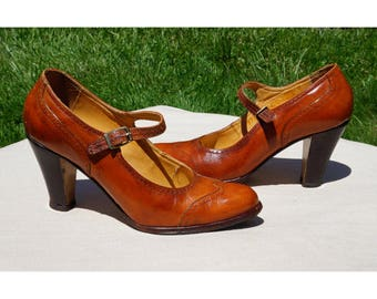 70s Chandlers Mary Jane Pumps, Cutouts, Medium Brown Leather. Wood heels 3""