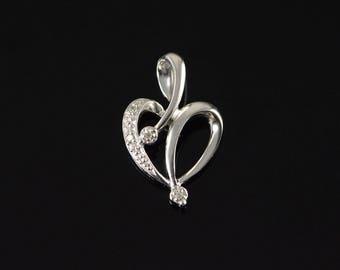 10k Diamond Encrusted Cutout Heart Pendant Gold