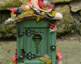 Wooden Fairy house, keys cabinet with metal key hooks.