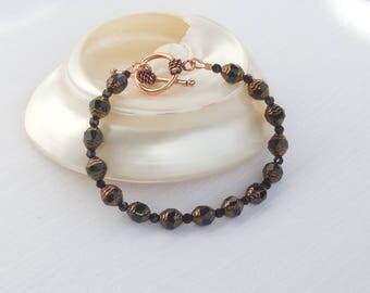 Black and antiqued copper glass bracelet