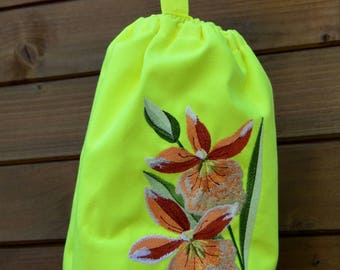 neon yellow bag with flowers