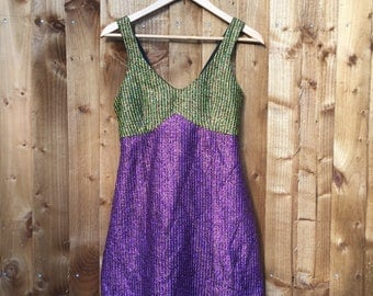 60s vintage sparkly mini dress by Damzels in this dress