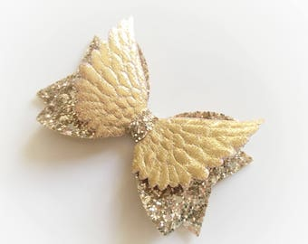 Angel wing gold glitter hair bow - alligator clip