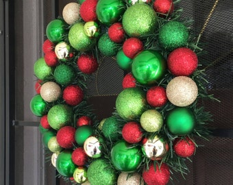 Ornament evergreen wreath . Green Red gold glitter ornament wreath . Christmas ornaments wreath .