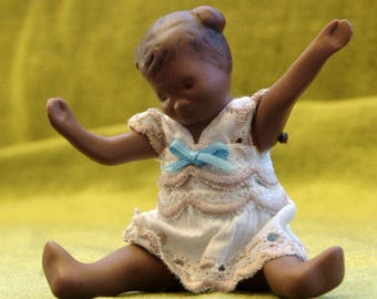 Sweet little porcelain black girl doll with lace dress