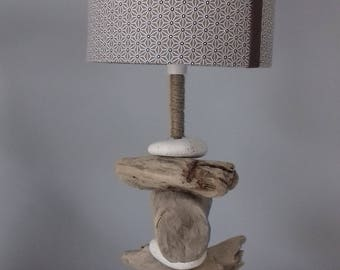 Lamp driftwood and pebbles