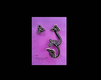 Asymmetrical earrings. Silver, enamel