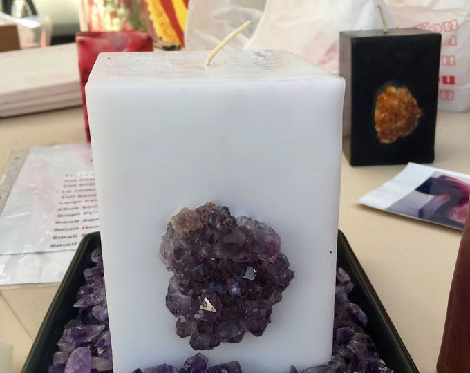 Crystal Candle ~ White or Black Chub Square Candle with an inlaid Amethyst Crystal Cluster that illuminates when lit! Burns for 175  hours