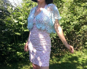 Crocheted Bolero romantic woman light blue with lace rosettes handmade short sleeved