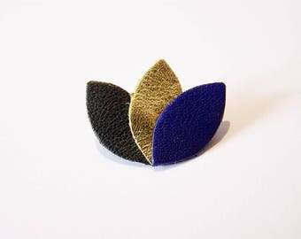 Black leather, gold and dark blue petals brooch