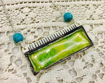 Bright green porcelain jewel necklace on silver chain.