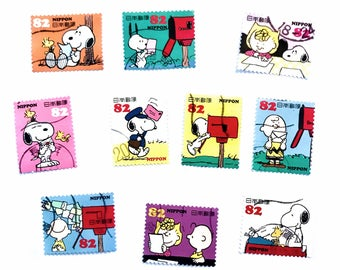 10 x Peanuts Snoopy Japanese used postage stamps - off paper all different - Japan - for crafts, stamp collecting, card making, scrapbooking