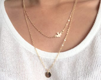 Double necklace with bird and circle