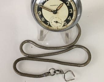 A vintage Ingersoll  pocket watch dial 1965 signed Ingersoll . Made in Gt. Britain. with snake albert