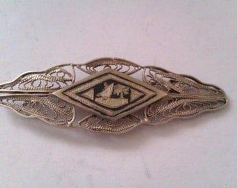 vintage silver coloured filigree brooch