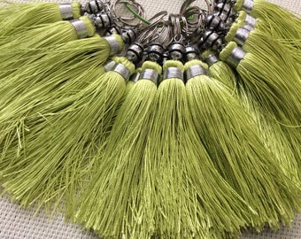 Tassel made of silk braided in almond green color