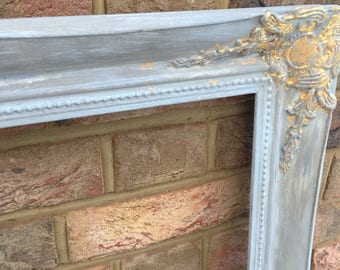 Sold!!!!               A large solid wood rococo pictureframe painted and gold leaf