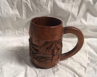 Vintage carved wooden mug
