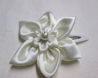 Adorned with ivory satin flower hair clip