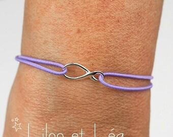 Infinity bracelet on mauve cotton thread, sterling silver