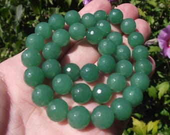2 Emerald faceted round 10MM beads. AT *.