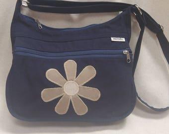 a beige flower decor blue shoulder bag