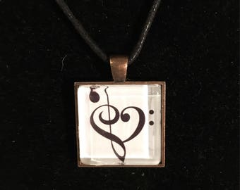 Treble clef and bass clef heart in a square necklace