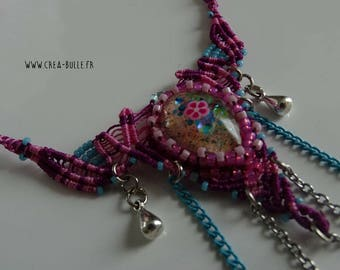 Necklace embroidered with a cabochon made of resin