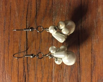 White dangle earrings