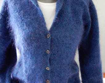 Lovely warm blue fitting vest. Blue with a purple shine