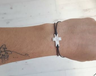 Black cross bracelet.