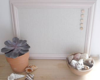 Pale pink linen covered pin board with heart pins