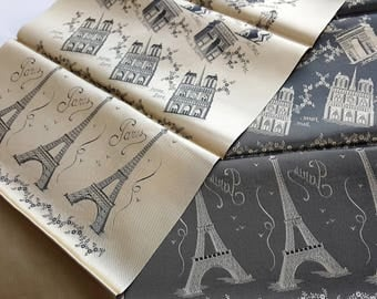 Vintage French scarf in beautiful champagne gold satin from the  1950's. Features Parisian landmarks such as Eiffel Tower, Arc De Triomphe.