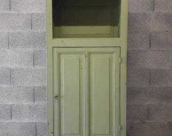 Green Paris cabinet from the 50s