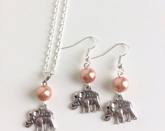 Adornment necklace and earrings Orange beads and elephant