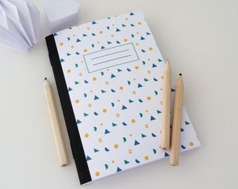 A6 notebook with small colorful geometric patterns