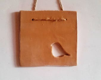 "Wall decoration in ceramic ""bird"" to hang, ocher look aged"