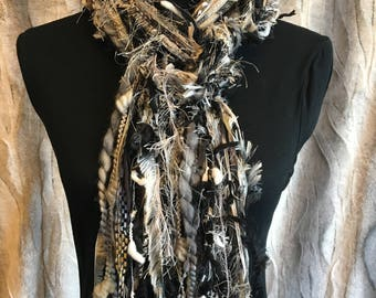 Unique fashion scarf in shades of black, white, grey, taupe and gold.