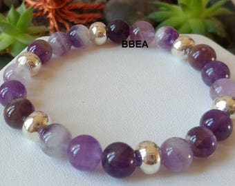 Amethyst Crystal Bracelet 8 mmx3 and silver beads.