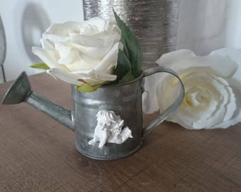 Small zinc watering can and her Cherub plaster