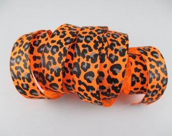 Fancy leopard grosgrain orange Ribbon width 26 mm.
