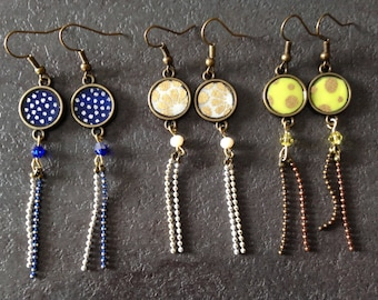 Long earrings with round cabochons.