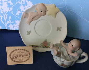 Rose O'Neill Kewpie 1994 Enesco Jesco Bisque Kewpie in Cup with Saucer Kewpie holding a Star