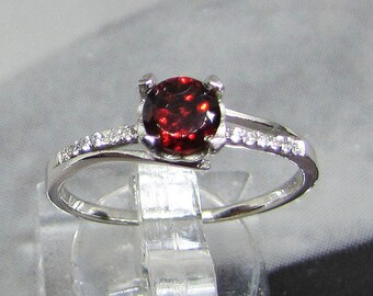 Silver ring (single ring) and 60 size Garnet stone