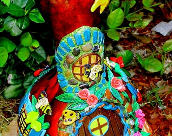 """Gourd Art, Fairy House, Red Gourd, """"In the Rose Garden"""" with Ladybugs, Bumble Bees, Sun, the Moon, flowers, mushrooms made of polymer clay."""