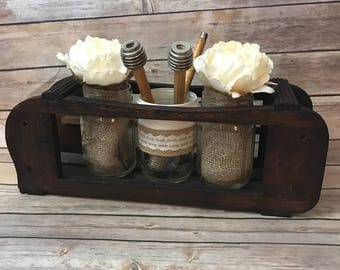 table centerpiece made from an antique sewing machine drawer frame