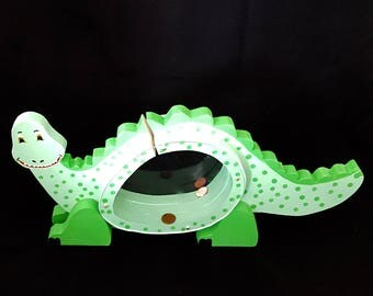 Dinosaur piggy bank, made from solid pine wood and painted green eyes
